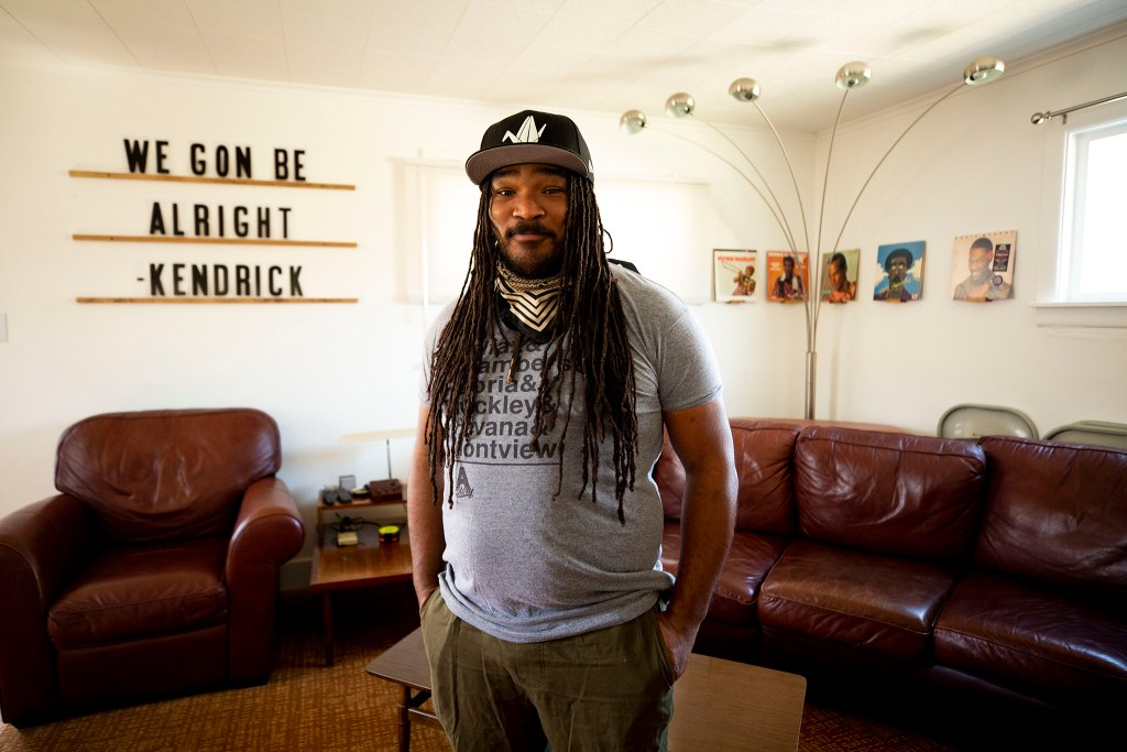 Poet Jovan Mays poses for a portrait in his home. April 10, 2020. (Kevin J. Beaty/Denverite)