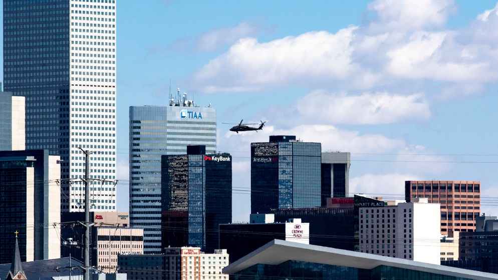 A blackhawk helicopter carrying U.S. Army Lt. Gen. Todd Semonite flies over Denver toward the Colorado Convention Center. April 14, 2020. (Kevin J. Beaty/Denverite)