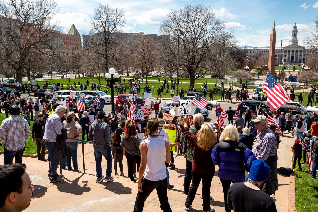 Protesters demand the end to Colorado's stay-at-home order at the state Capitol building. April 19, 2020. (Kevin J. Beaty/Denverite)