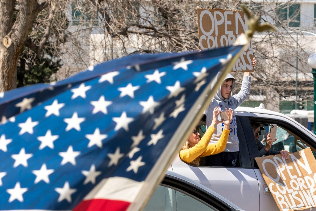 Protesters in cars circle the state Capitol, demanding the end to Colorado's stay-at-home order. April 19, 2020. (Kevin J. Beaty/Denverite)