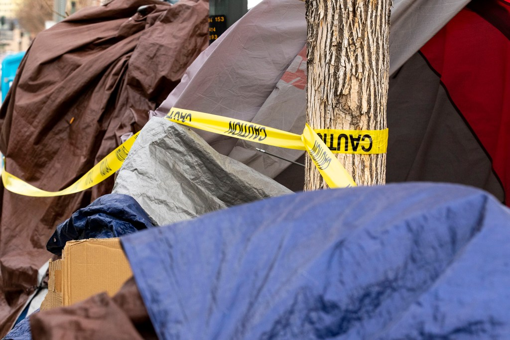Authorities oversee a cleanup of homeless encampments near the intersection of 22nd and Champa Streets in Five Points. April 30, 2020. (Kevin J. Beaty/Denverite)