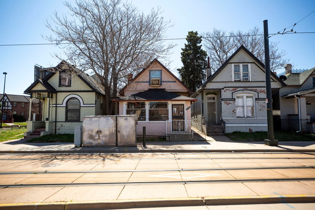 Homes on Welton Street owned by Robert and Eddie Woolfolk of the nonprofit Charity's House. May 1, 2020. (Kevin J. Beaty/Denverite)