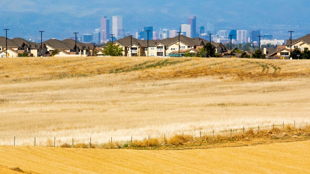 Downtown Denver seen from the future site of the Painted Prairie, a developing neighborhood by DIA in Aurora. May 14, 2020. (Kevin J. Beaty/Denverite)