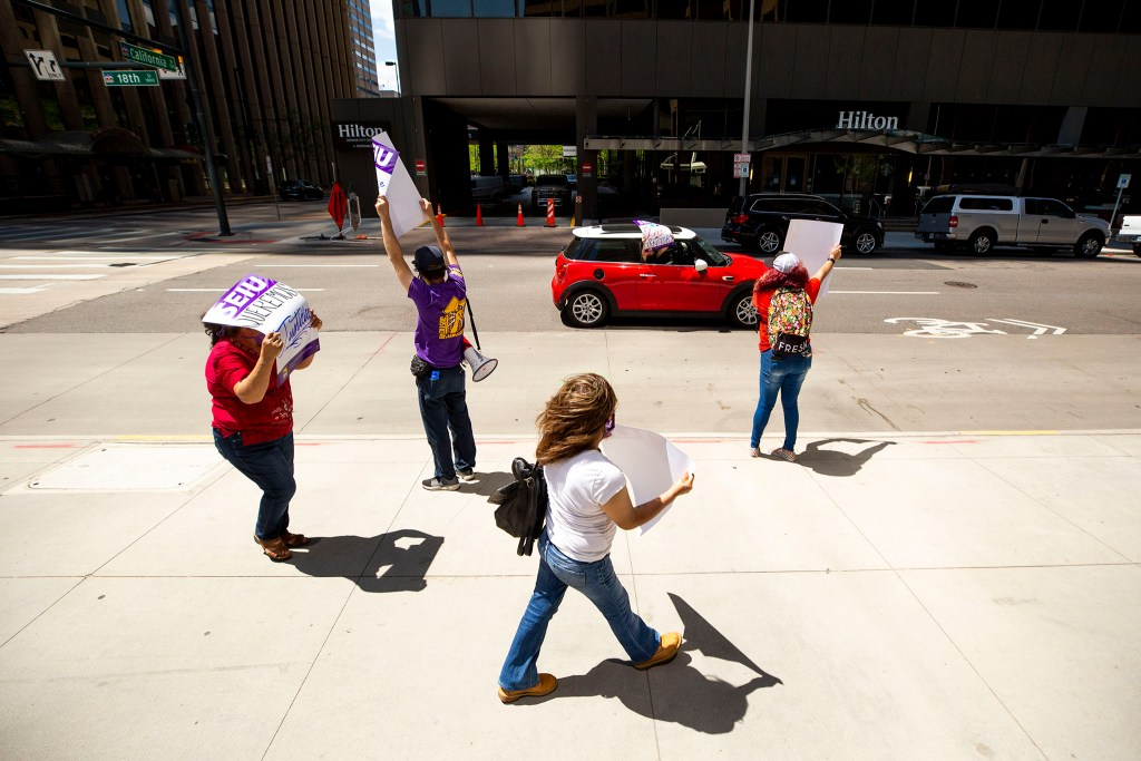 Service Employees International Union janitors protest for better safety measures and higher wages outside of 1801 California Street downtown. May 19, 2020. (Kevin J. Beaty/Denverite)
