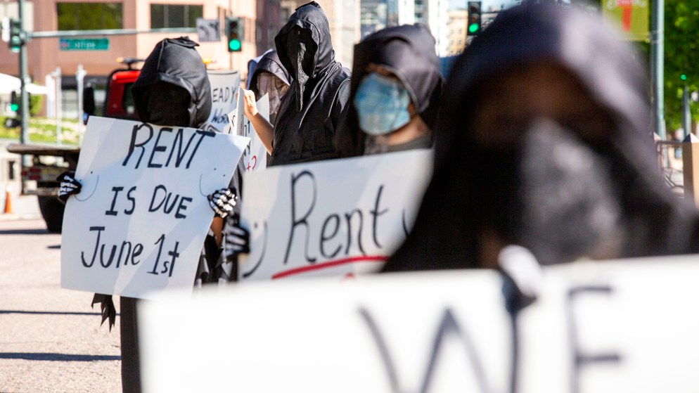 Denver Democratic Socialists, dressed as grim reapers, protest a lack of eviction protections in front of the Capitol. May 26, 2020. (Kevin J. Beaty/Denverite)