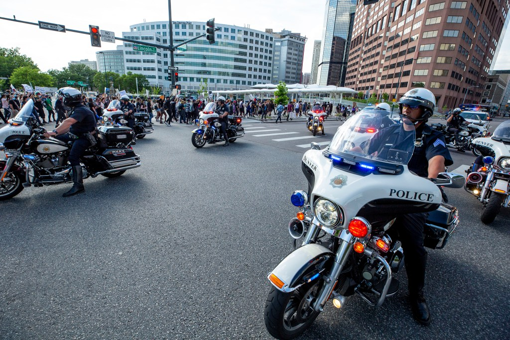 Denver Police motorcycle officers block Lincoln Street as a march in reaction to the death of George Floyd leaves the Capitol. May 28, 2020. (Kevin J. Beaty/Denverite)