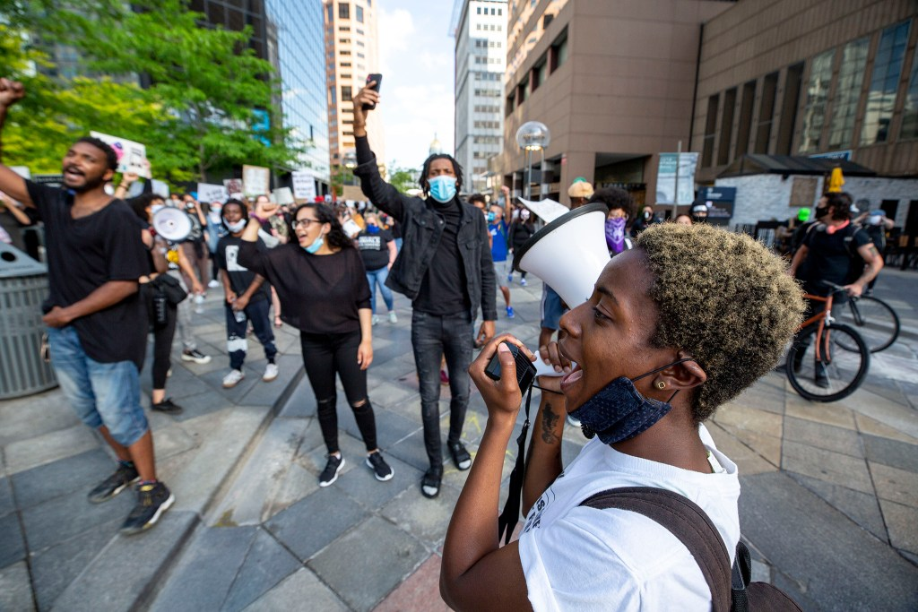 Keezy A. leads a march reacting to the death of George Floyd down the 16th Street Mall. May 28, 2020. (Kevin J. Beaty/Denverite)
