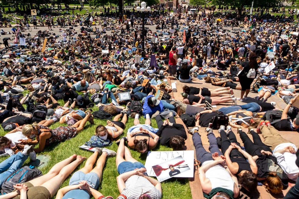 """Protesters lie """"dead"""" chanting, """"I can't breathe,"""" for nine minutes on day three of protests in reaction to the killing of George Floyd. May 30, 2020. (Kevin J. Beaty/Denverite)"""