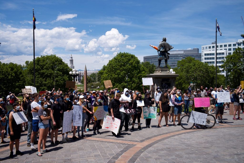 People gather for a fourth day of protest at the Capitol building in Denver on Sunday, May 31, 2020.