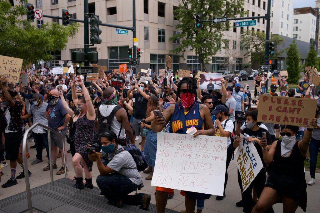 Prostesters march in Denver on Sunday, May 31, 2020. (Carl Glenn Payne/For Denverite)