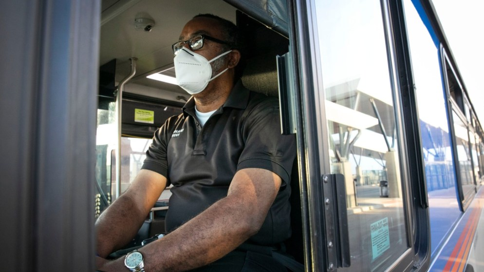 An RTD driver in a face mask waits at RTD's Central Park Station Thursday morning, April 9, 2020. The Regional Transportation District could lose a quarter of a billion dollars in revenue, and potentially more, because of fallout over work, jobs and the economy because of coronavirus.