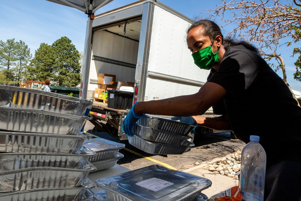 Eris Griffin work at the Struggle of Love Foundation's food pantry in Montbello. May 18, 2020. (Kevin J. Beaty/Denverite)