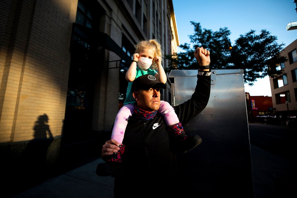 Jeremy and Evelyn Raile cheer on marchers during the sixth day of protests in reaction to the killing of George Floyd by Minneapolis police. June 2, 2020. (Kevin J. Beaty/Denverite)