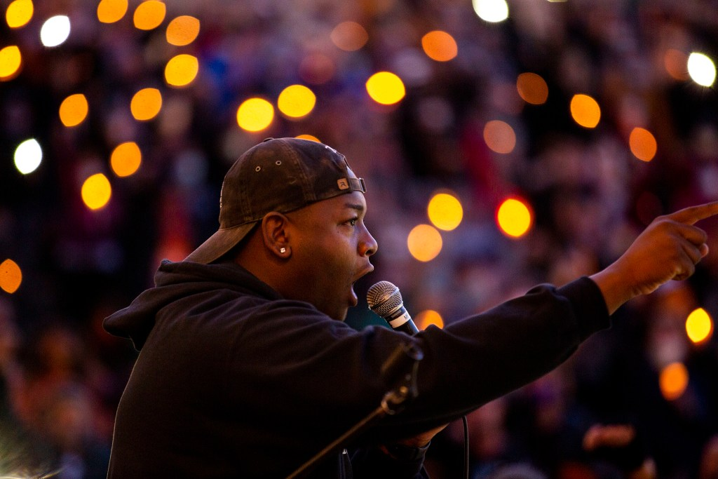 Tay Anderson leads the crowd in a chant during a vigil for George Floyd at Civic Center Park on the day of his burial. June 9, 2020. (Kevin J. Beaty/Denverite)