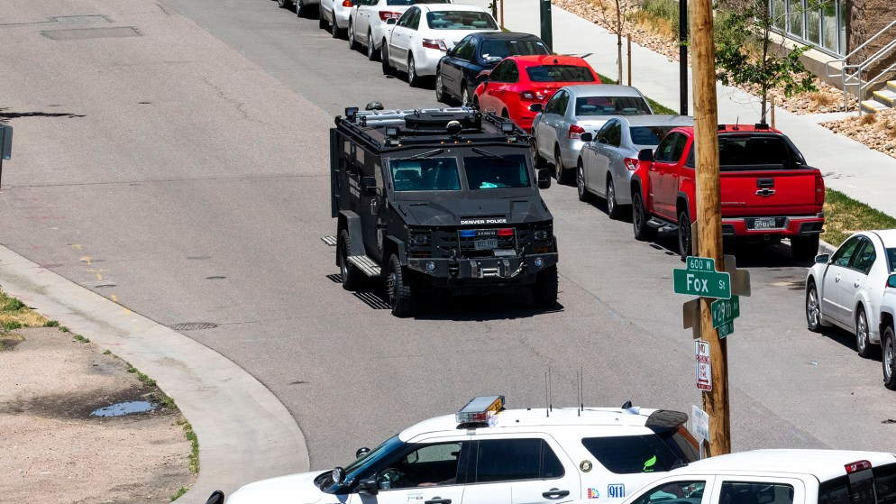 A SWAT vehicle rounds the corner of Fox and 29th Streets as authorities respond to a shooting in the Ballpark area of Five Points. June 10, 2020. (Kevin J. Beaty/Denverite)