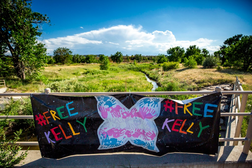 Signs calling for Kelly González Aguilar's release hang near a protest camp outside of the Aurora Contract Detention Facility. June 22, 2020. (Kevin J. Beaty/Denverite)