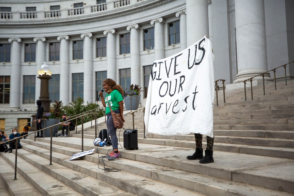 DonQuenick Beasley speaks during the Denver People's Town Hall on the City and County Building steps on June 29, 2020. (Kevin J. Beaty/Denverite)