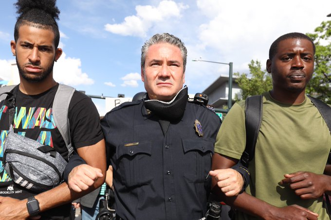 Denver Police Chief Paul Pazen marches with protesters during the fifth day of demonstrations against the death of George Floyd in Denver on Monday, June 1, 2020. (Hart Van Denburg/CPR News)