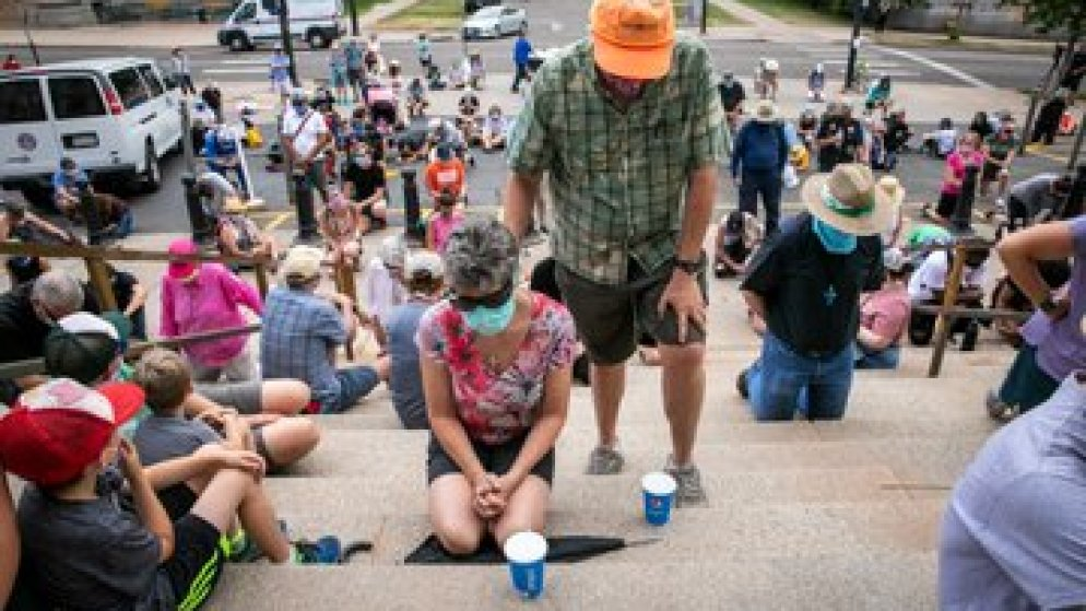 A prayer vigil and march against racism and police brutality today started at Denver's St. John's Cathedral, and stopped for moments of silence at the state Capitol and District 6 police station. (Hart Van Denburg/CPR News)