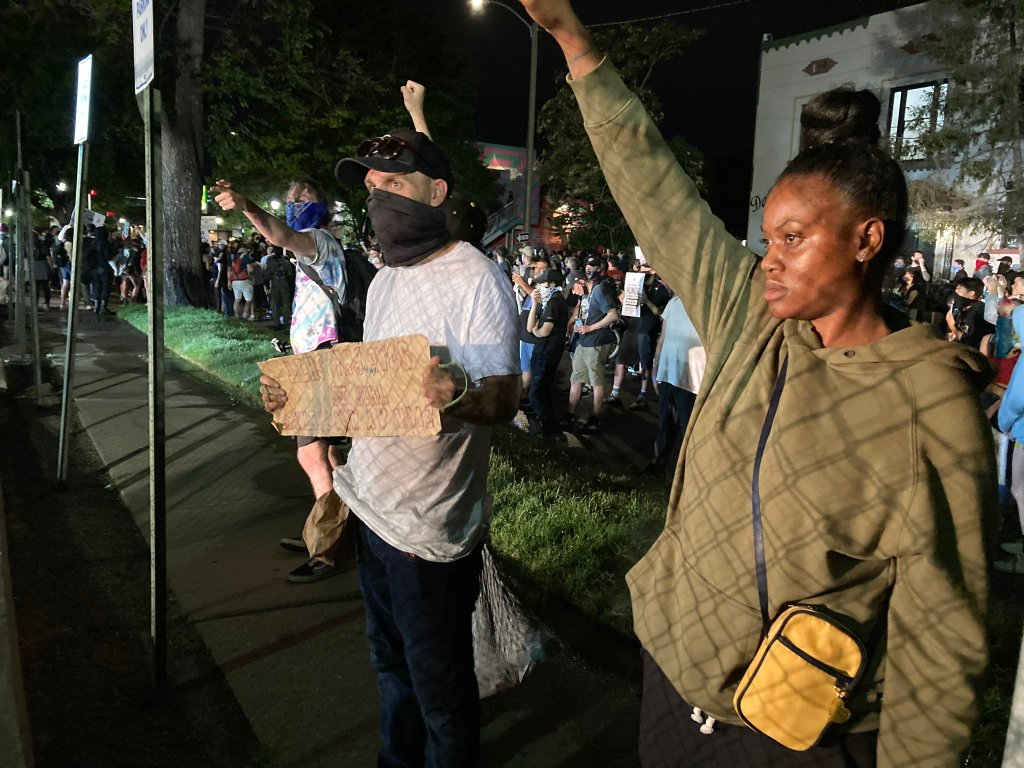 Protesters gathered outside a Denver police precinct on Friday, June 5, 2020, to protest racism and police brutality for the ninth night in a row.