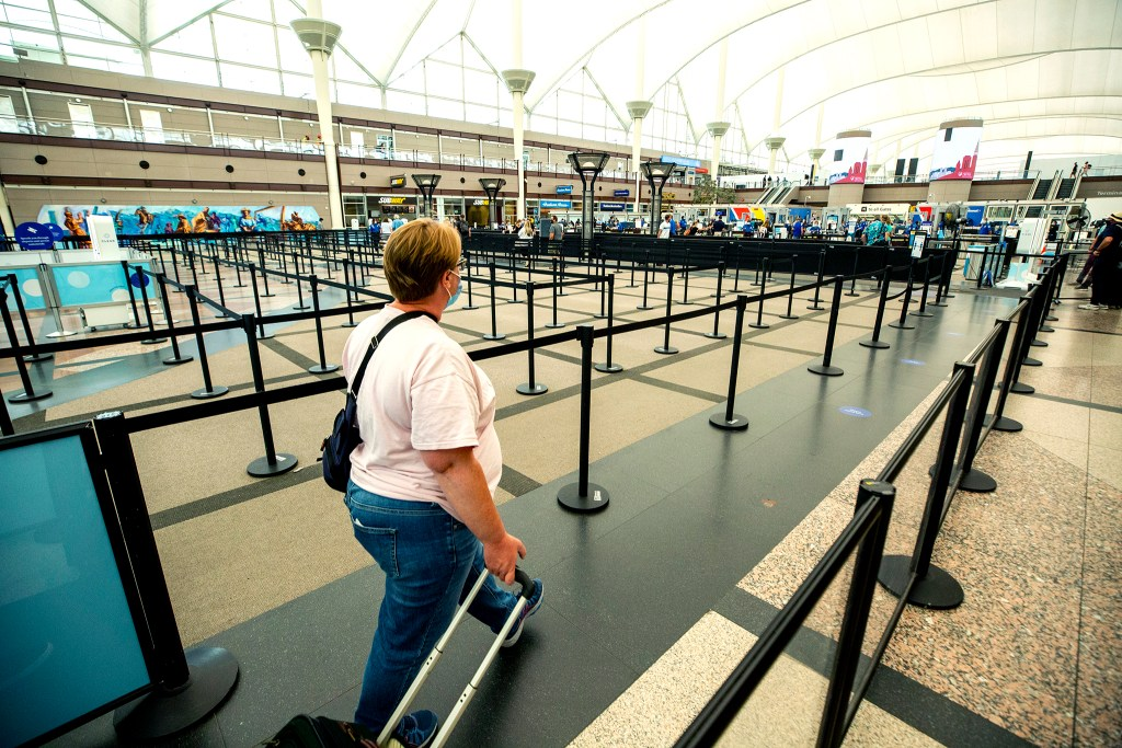 The TSA line at Denver International Airport is scant on a Tuesday afternoon. July 7, 2020.