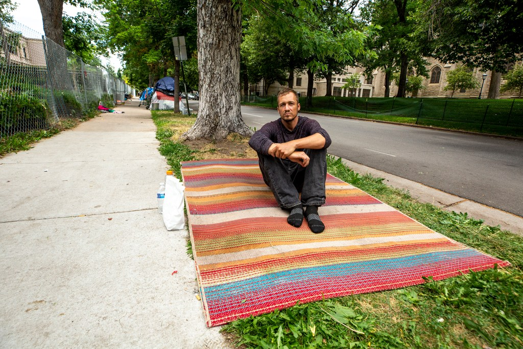 Brian Bostrad sits on a blanket outside of Morey Middle School in Capitol Hill, where he's been living for the past few weeks. July 9, 2020.