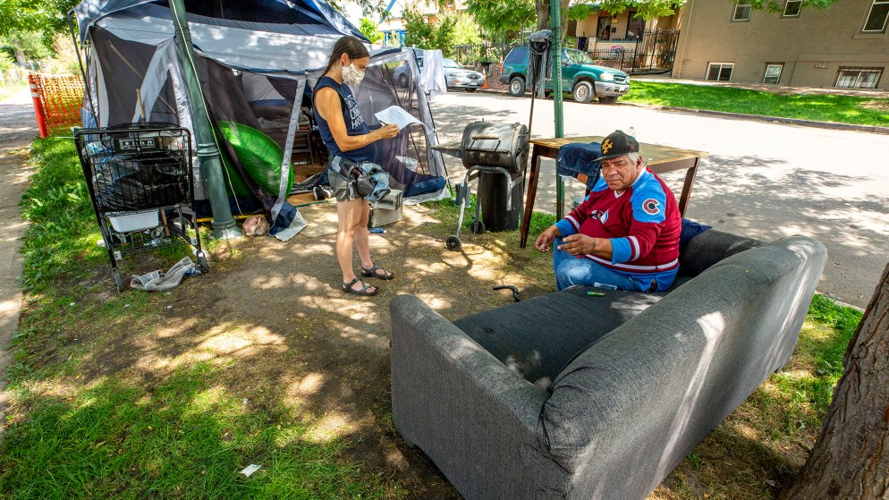 Terese Howard speaks with Vince Martinez during Denver Homeless Out Loud's own count of tents in the city. July 17, 2020.