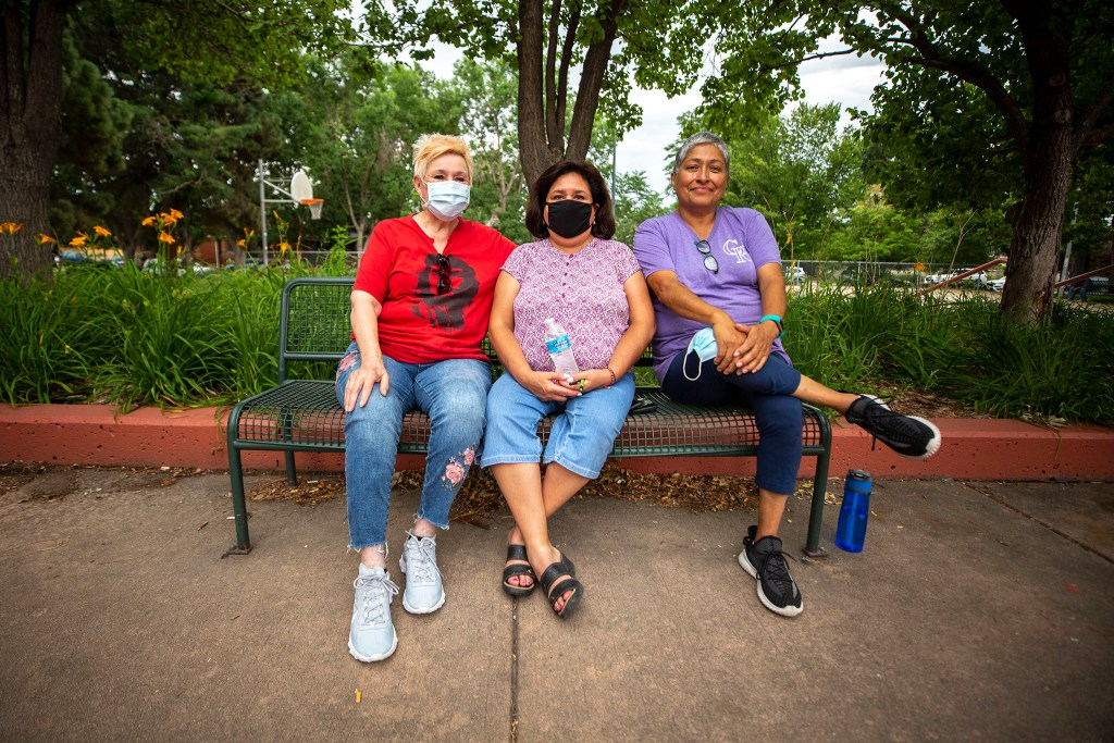 Cecilia Apodaca, Anna Castaneda and Diane Medina hang out after they signed a petition to change the name of Columbus Park to La Raza Park. July 24, 2020.