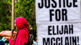 Jordan Cain leads a protest demanding justice for Elijah McClain at Aurora's municipal complex. July 25, 2020.