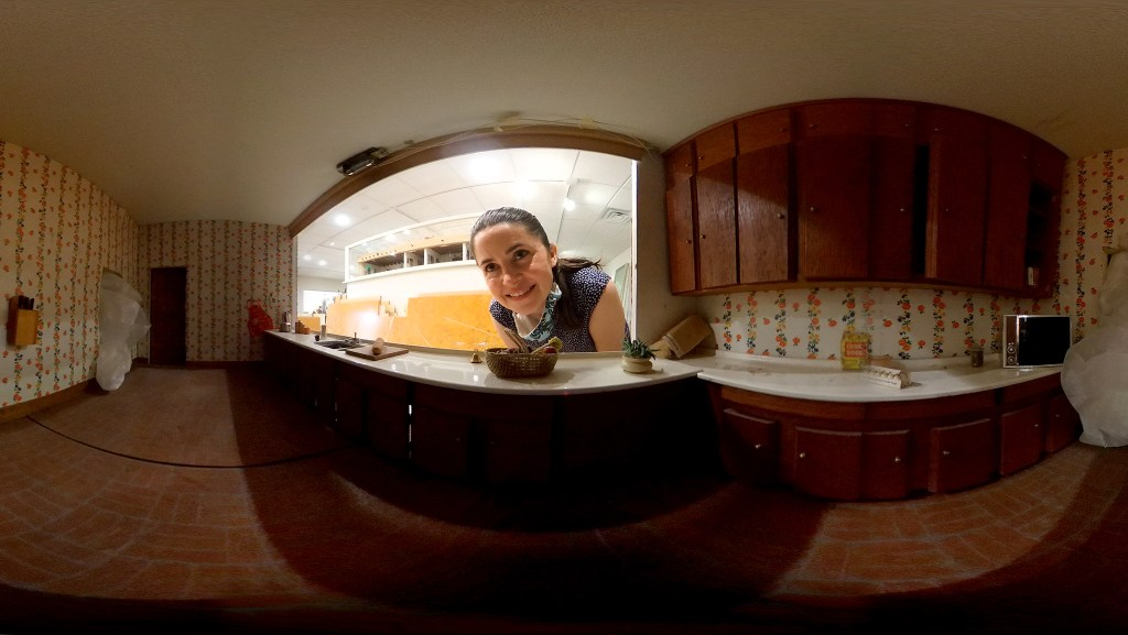 Wendy Littlepage, director of the Denver Museum of Miniatures, Toys and Dolls, peers into a dollhouse at their new Lakewood headquarters. July 28, 2020.