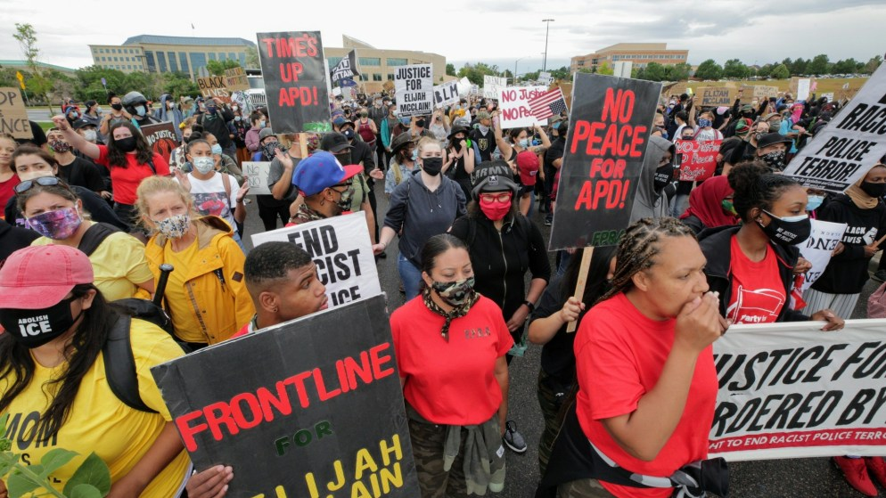 Protesters in Aurora on July 25, 2020, demand justice in the death of Elijah McClain