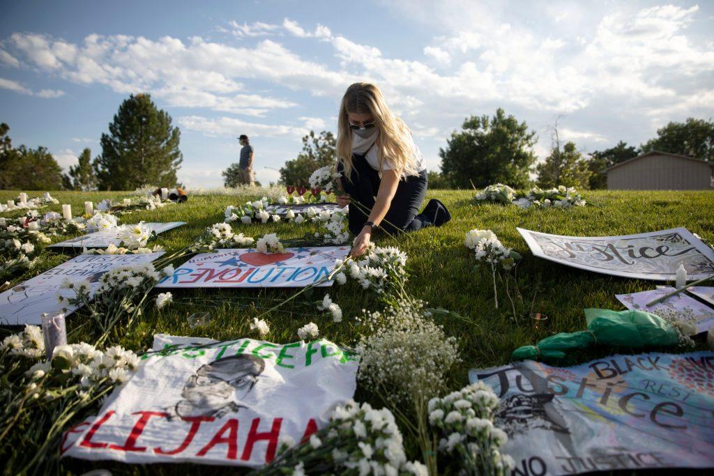 Flower memorial at a vigil for Elijah McClain in Aurora on July 11, 2020