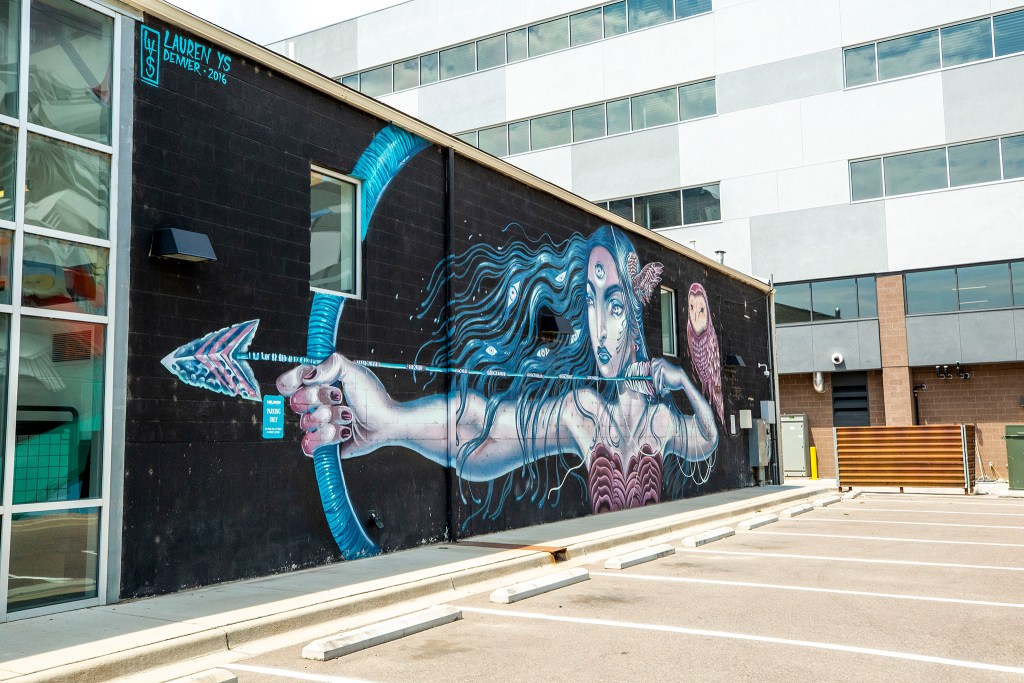 A mural by Lauren LS on the Helikon Gallery and Studios, 3675 Wynkoop St. in Five Points. Aug. 5, 2020.