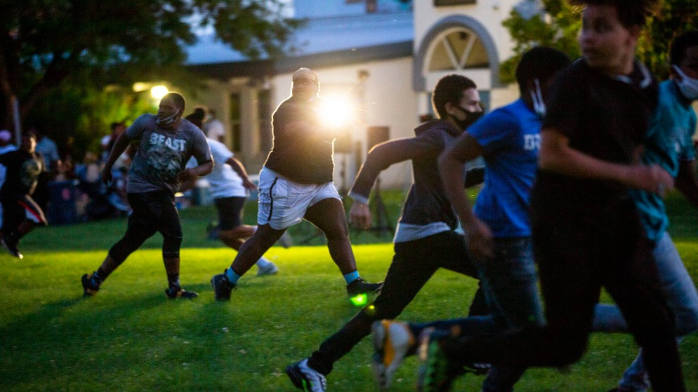 "Kids play football during a ""safe space"" night at the St. Charles Rec Center in Cole. Aug. 8, 2020."