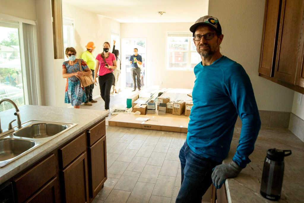 Developer Adam Berger stands inside a modular housing unit he designed that's being installed on land provided by the Colorado Community Land Trust in Elyria Swansea. Aug. 12, 2020.