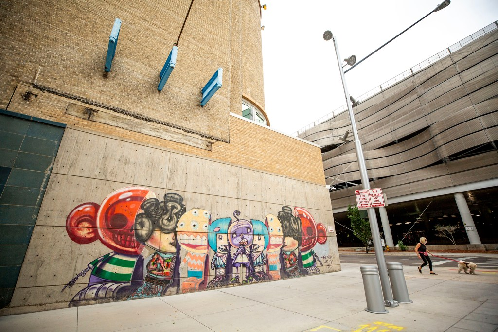 A mural by David Cho on the Denver Performing Arts Complex at 13th and Champa Streets. Aug. 12, 2020.