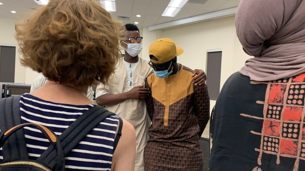 Moussa Diol (center, in the hat) on Friday, August 7, after speaking during a press conference on the fire in Denver that killed member of his family. (Esteban L. Hernandez/Denverite)