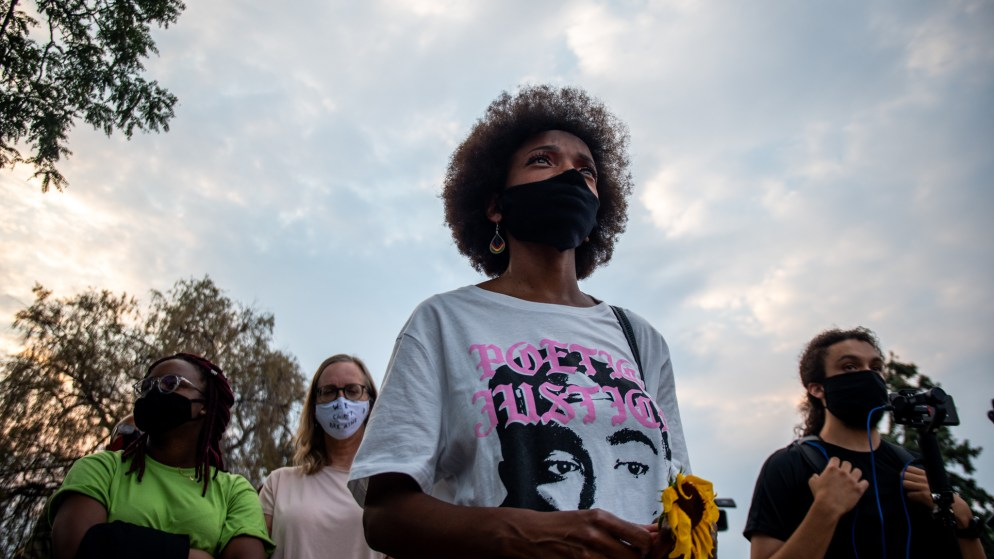 "Sheree Barbour listens to a speaker during the ""Protect Black Men: Colorado Action for Jacob Blake"" gathering at Manual High School in Denver. Hundreds gathered in support of Jacob Blake, a Black man shot at least seven times in the back by police in Wisconsin."