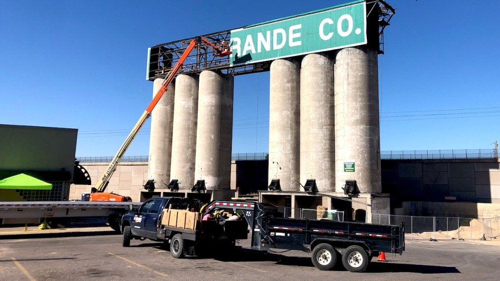 A crew of two tears down the Rio Grande Sign at 123 Santa Fe Dr. in Baker on August 7, 2020.