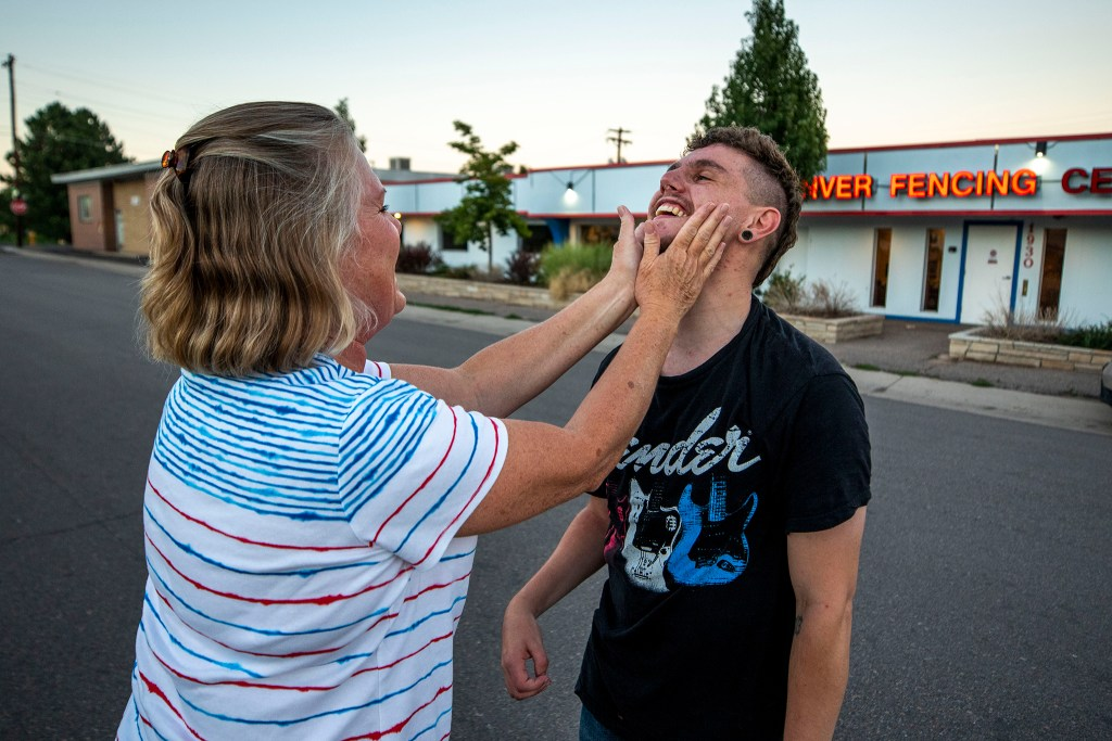 Susan Engdahl embraces her son, Terre, outside of the Denver Fencing Center in Ruby Hill. Sept. 1, 2020.