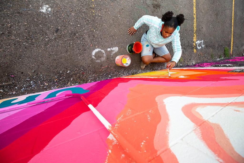 Jordan Ward at work on a CRUSH Walls 2020 mural at the Denver Central Market on Larimer Street. Sept. 18, 2020.