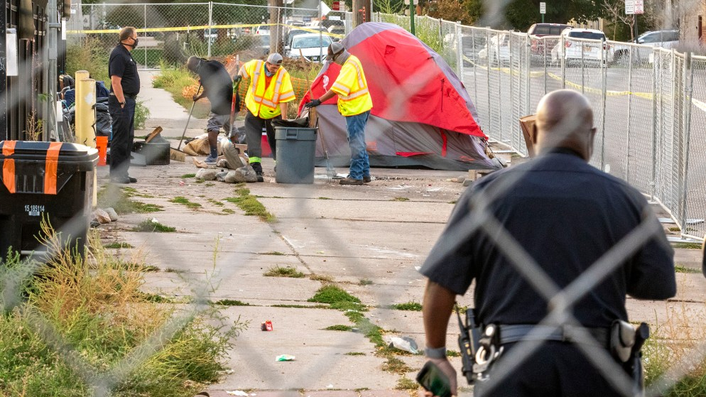 A forced cleanup of encampments along Arapahoe Street in Five Points. Sept. 22, 2020.