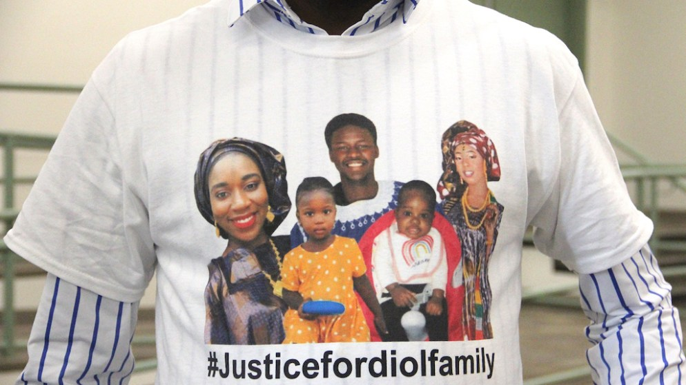 Pap Dia wears a shirt showing the victims of a fire in Green Valley Ranch. From left: Adja Diol, Khadija Diol, Djibril Diol, Hawa Beye and Hassan Diol. (Esteban L. Hernandez/Denverite)