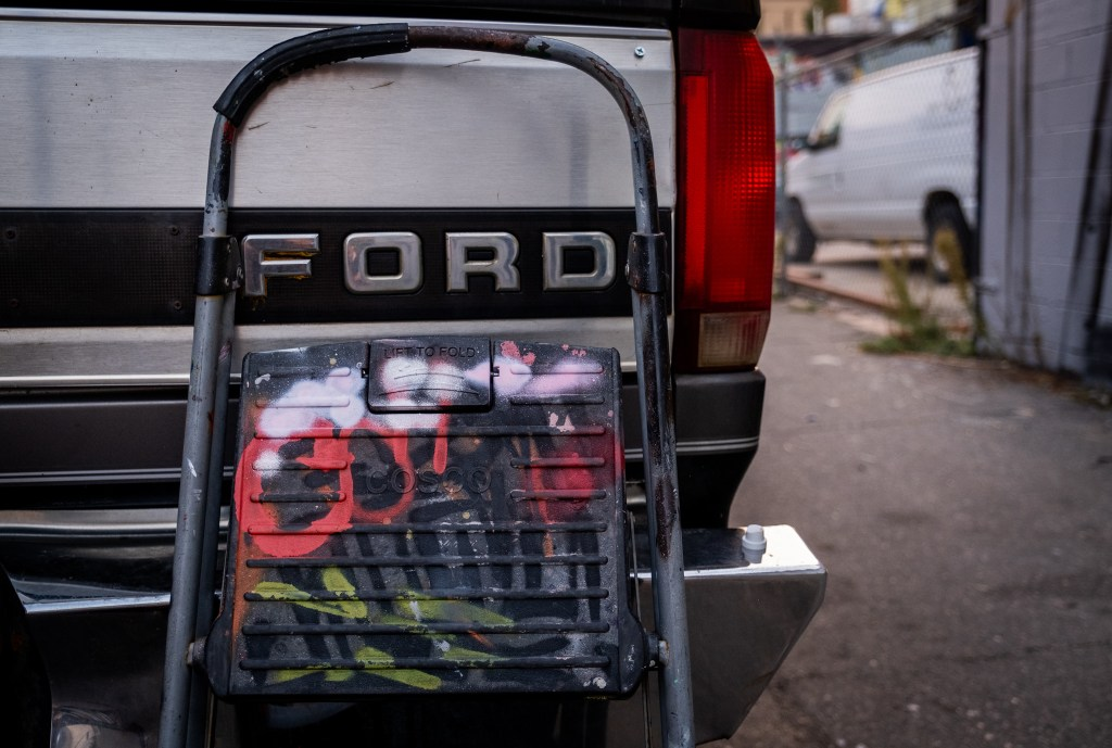 A step stool covered in paint leans on an artist's truck in a River North Art District alleyway on Sept. 17, 2020.