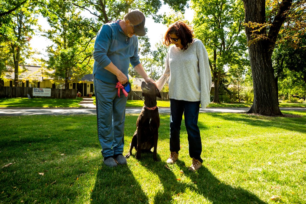 Josh (left to right), Junebug and MJ Weiss, out for a walk along the 6th Avenue Parkway on the edge of Denver's Hilltop neighborhood. Oct. 1, 2020.