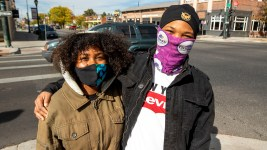 Katelyn Trujillo and Moses Malavet were already wearing a mask outside when Denver's tighter rules on face coverings was announced. Oct. 16, 2020.