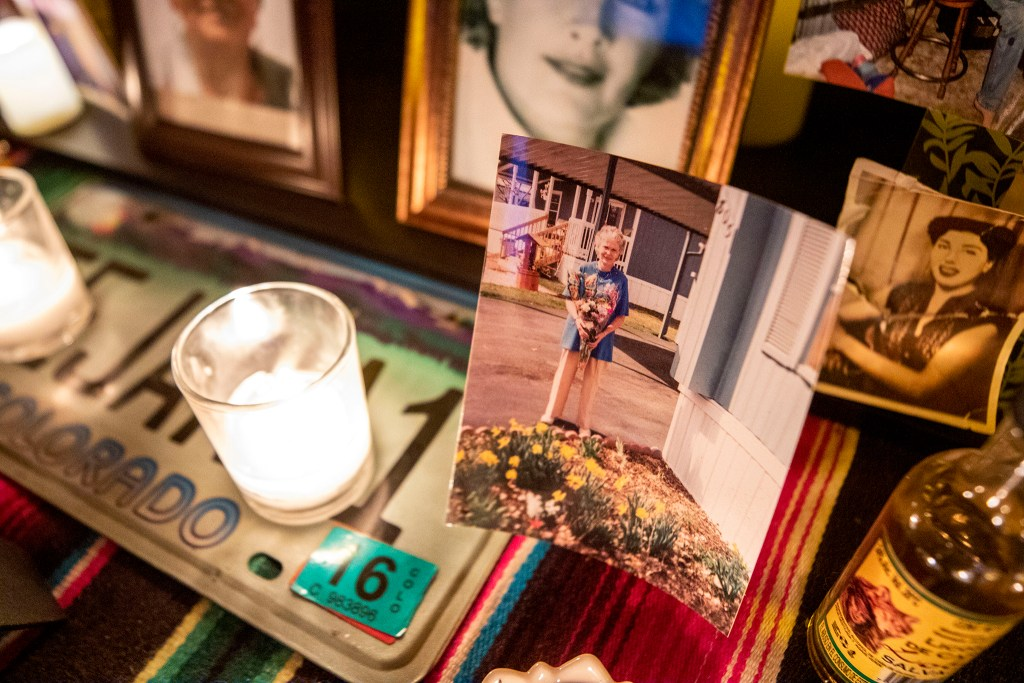 Katherine Crawford is memorialized in the ofrenda Paul Stephens and Christopher Jorgenson built on their front porch in Harvey Park. Oct. 29, 2020.
