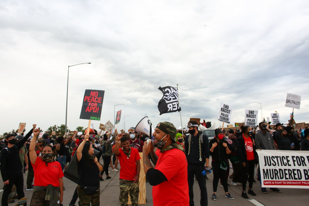 Terrance Roberts leads protesters in a march calling for justice for Elijah McClain in Aurora, CO, July 25, 2020.  Photo by Kevin Mohatt