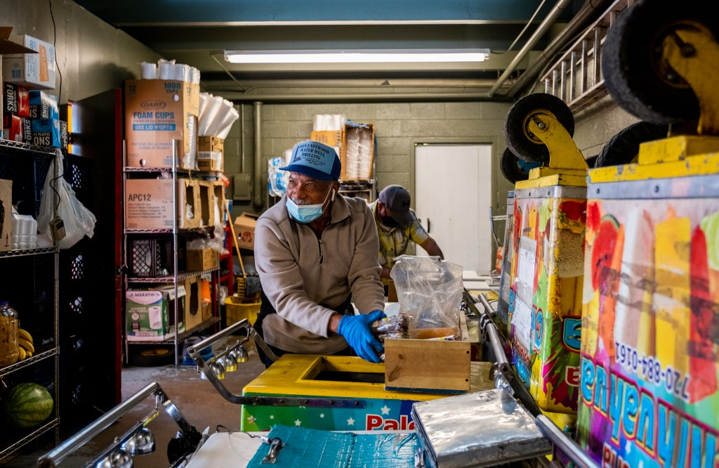 Octavio Delgado, 58, packs paletas, or Mexican popsicles, into his cart in the back of Paletería Chihuahua in Cole on Oct. 8, 2020. The cart can hold around 300 paletas.