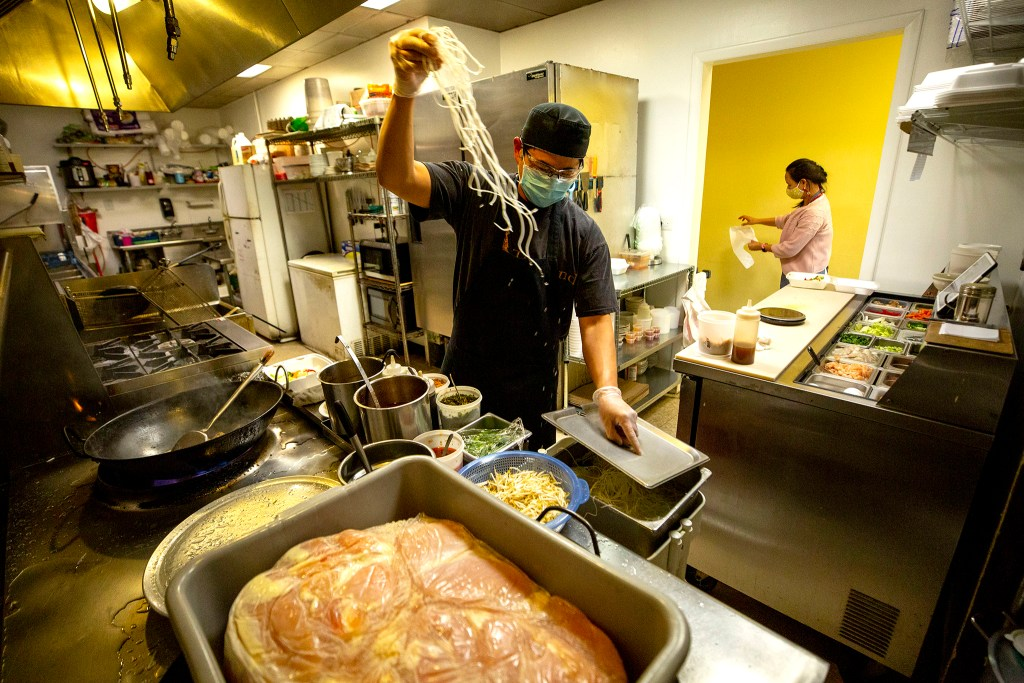 Prince and Lek Nuntanavooth work the dinner shift at J's Noodle & Star Thai Delivery on Federal Boulevard. Oct. 28, 2020.